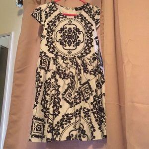 Pleated Lulu's midi dress with pattern. Never worn